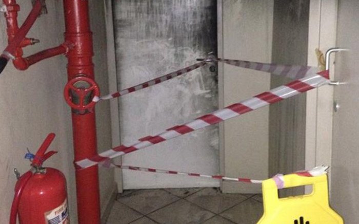 Building manager Raymond Whittles tried to open the door of the flat in which a 12-year-old died after a fire broke out at Harbour View flats in Woodstock on Sunday 27 July 2014. Picture: Mia Spies/EWN.