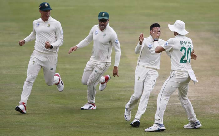 South Africa's Keshav Maharaj (2ndR) celebrates with teammates after the dismissal of England's Ben Stokes during the fourth day of the first Test cricket match between South Africa and England at The SuperSport Park stadium at Centurion near Pretoria on 29 December 2019.