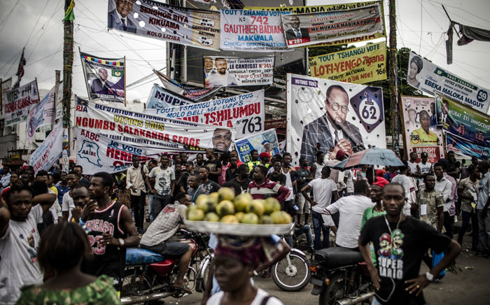 FILE: Electoral banners are displayed in the Ndjili district of Kinshasa on 19 December 2018, after campaigning for Democratic Republic of Congo's general elections was called off in Kinshasa by the authorities on security grounds. Picture: AFP.