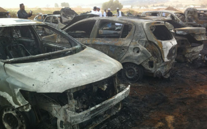 25 cars were set alight at the Muslim Ijtima event in Woodmead, northern Johannesburg, on 29 March 2013. Picture: Reinart Toerien/EWN