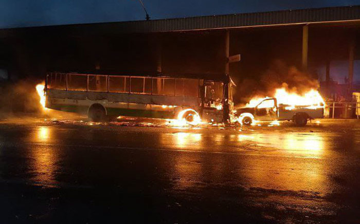 A Golden Arrow bus and another vehicle were set alight at the Nyanga terminus on 28 May 2021. Picture: Supplied
