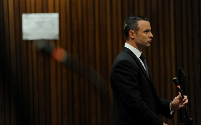 Oscar Pistorius stands in the dock at the High Court in Pretoria as Judge Thokozile Masipa rules on an application to have him referred for mental observation, 14 May 2014. Picture: Live feed.