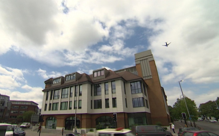London building where stowaway's body was found after falling from aircraft. Screen print: CNN
