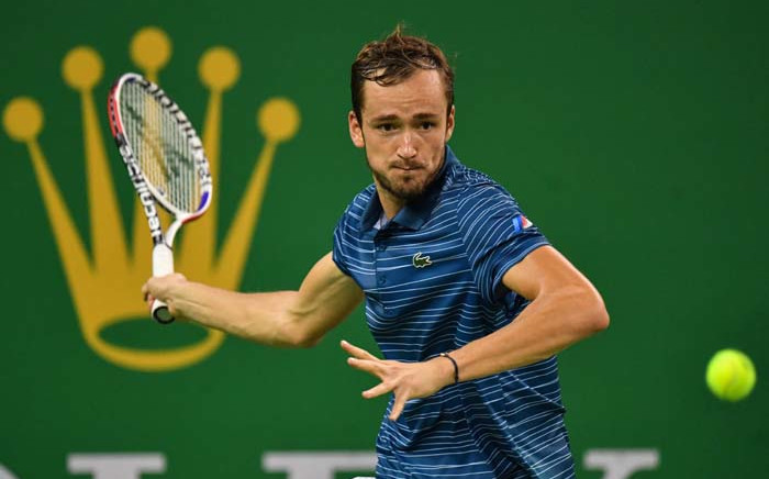 Daniil Medvedev of Russia hits a return against Alexander Zverev of Germany during their men's singles final match at the Shanghai Masters tennis tournament in Shanghai on 13 October 2019. Picture: AFP