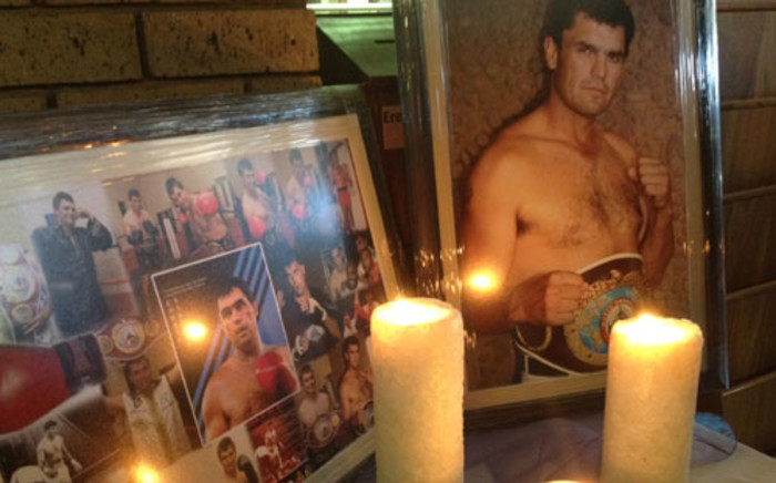 A shrine, in remembrance of boxing legend Corrie Sanders, at the entrance to the church where his funeral service was held. Picture: Barry Bateman/EWN