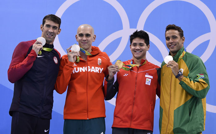 Singapore's Schooling Joseph (2ndR) poses with silver medallists (fromL) USA's Michael Phelps, Hungary's Laszlo Cseh and South Africa's Chad Guy Bertrand Le Clos after he won the Men's 100m Butterfly Final during the swimming event at the Rio 2016 Olympic Games at the Olympic Aquatics Stadium in Rio de Janeiro on 12 August, 2016. Picture: AFP.
