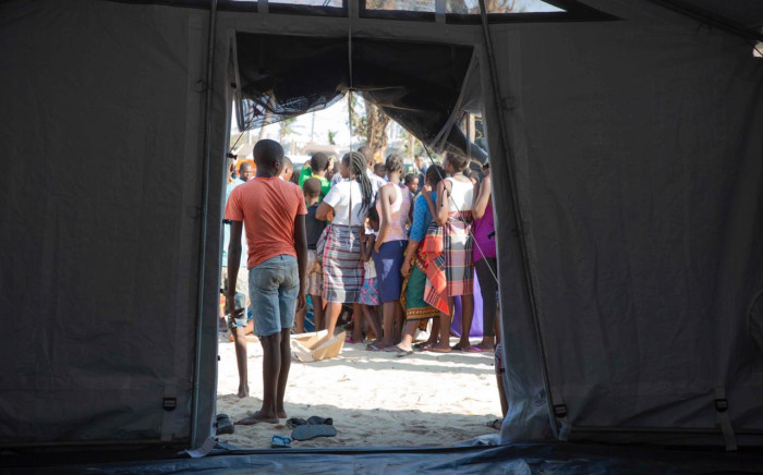FILE: People wait in line for food at a relief camp set up for victims of Cyclone Idai who have fled to Beira. Picture: Christa Eybers/EWN