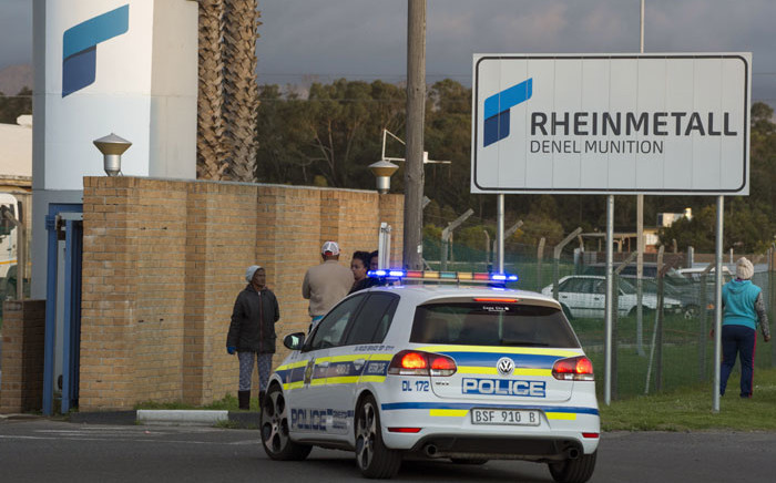 Police vehicles at the Rheinmetall Denel munitions facility in Macassar, Cape Town, after an explosion at the facility killed at least 8 people and injured more on 3 September 2018. Picture: AFP