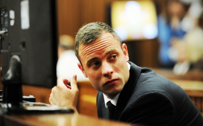 Murder accused Oscar Pistorius in the High Court in Pretoria for the 13th day of his trial, 19 March 2014. Picture: Pool.