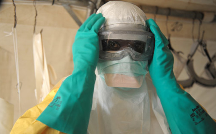 FILE: Health specialists prepare for work in an isolation ward for patients at the Doctors Without Borders facility in Guinea. Picture: AFP.