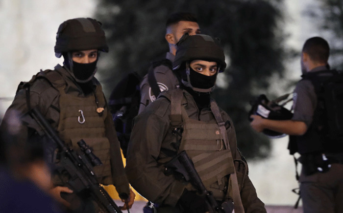 Masked members of the Israeli security forces patrol outside Damascus Gate in Jerusalem's Old City on 16 June 2017 following an attack. Picture: AFP.