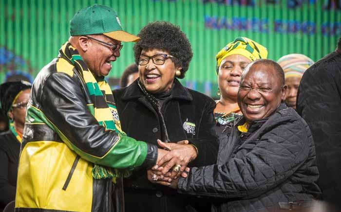 Winnie Madikizela-Mandela clasps the hands of President Jacob Zuma and Deputy President Cyril Ramaphosa at the ANC national policy conference at Nasrec on 30 June 2017. Picture: Thomas Holder/EWN