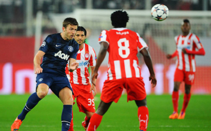 Manchester Unites' Michael Carrick, heads the ball away during the Champions League last 16 firast leg against Olympiakos Piraeus in Athens on 25 February 2014. Picture: Facebook.