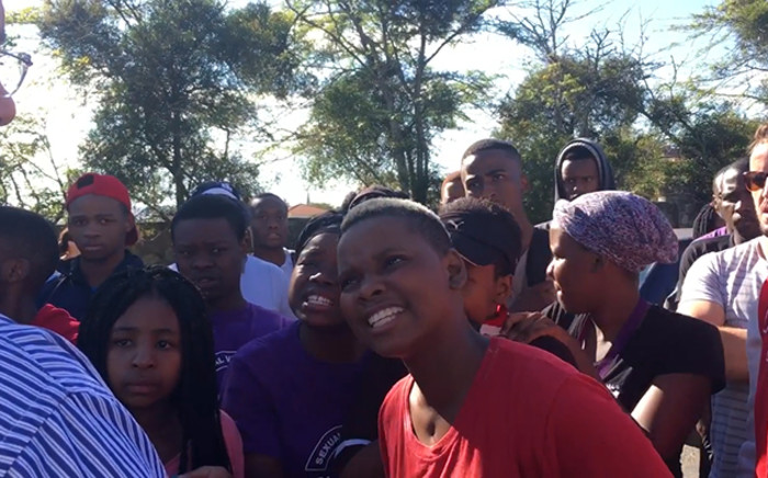 Rhodes University students confront a lecturer whom they accuse of calling in the police to arrest them during anti-rape protests on campus. Picture: Govan Whittles/EWN