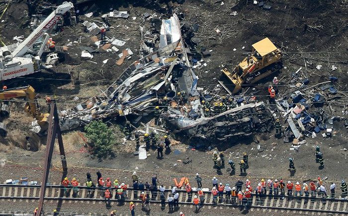 Investigators and first responders work near the wreckage of Amtrak Northeast Regional Train 188, from Washington to New York, that derailed yesterday 13 May, 2015 in north Philadelphia, Pennsylvania. Picture: AFP.