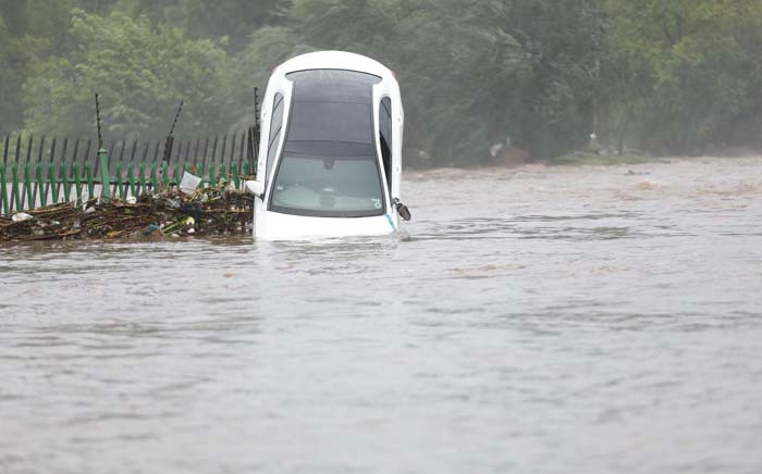 A car water-logged during flash floods in Centurion, Tshwane, on 9 December 2019. Picture: Abigail Javier/EWN