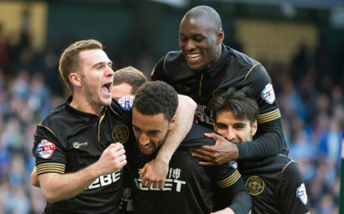 Wigan Athletic players celebrate their heroic victory over Manchester City in the FA Cup quarter-final on 9 March 2014. Picture: Facebook.com