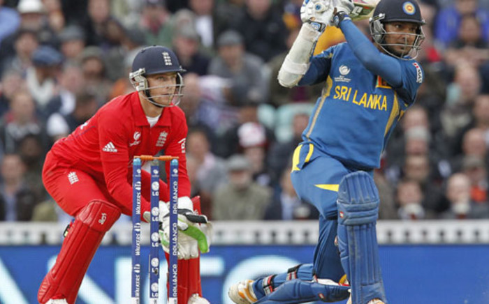 Sri Lanka's Kumar Sangakkara (R) hits a shot watched by England's wicketkeeper Jos Buttler during the 2013 ICC Champions Trophy cricket match between England and Sri Lanka at The Oval cricket ground in London, on June 13, 2013. Picture: AFP.