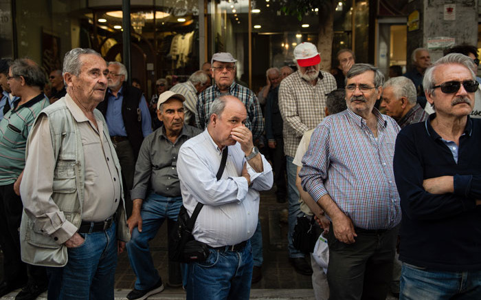 FILE: Pensioners take part in a demonstration outside the Ministry of Finance against planned pension reforms, in central Athens, 25 April, 2018. Picture: AFP