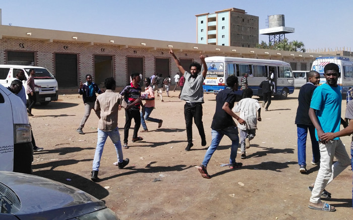 FILE: A picture taken on 13 January 2019 shows anti-government demonstrators in the Sudani capital Khartoum. Sudanese police fired tear gas today at crowds of anti-government protesters in Khartoum after organisers called for nationwide rallies against President Omar al-Bashir. Picture: AFP