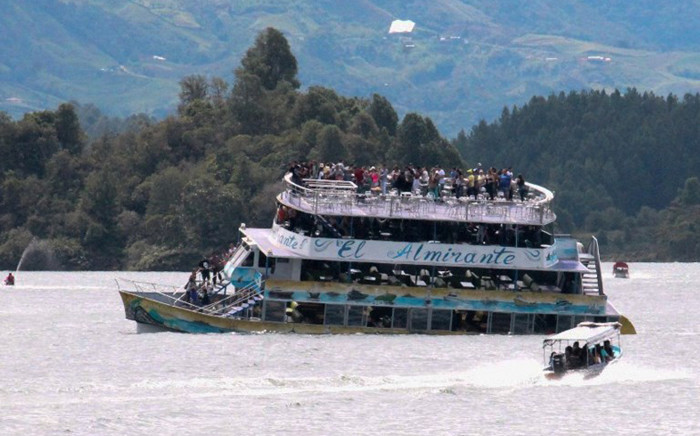 The tourist boat Almirante is seen in the Reservoir of Penol in Guatape municipality in Antioquia on June 25, 2017. Picture: AFP.
