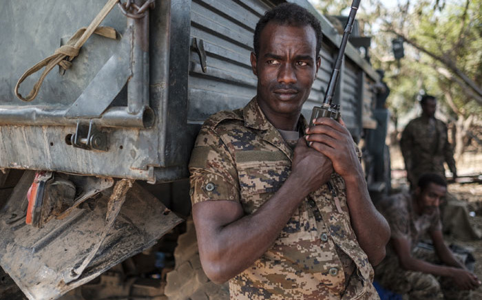 FILE: An Ethiopian soldier stands with a walkie talkie in his hand at the 5th Battalion of the Northern Command of the Ethiopian Army in Dansha, Ethiopia, on 25 November 2020. Picture: AFP