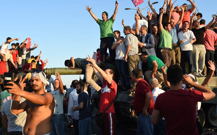 People react after they take over a military position on the Bosphorus bridge in Istanbul, Turkey, on 16 July 2016. Picture: AFP.