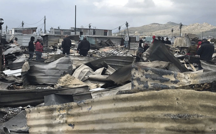 FILE: Masiphumelele residents survey the damage a day after a fire swept through the settlement on 29 July 2019. Picture: Monique Mortlock/EWN