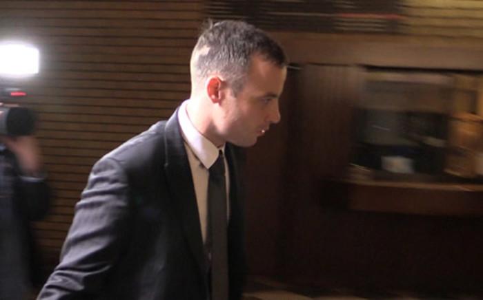 Oscar Pistorius enters the High Court in Pretoria ahead of his murder trial on 17 April 2014. Picture: Christa van der Walt/EWN.