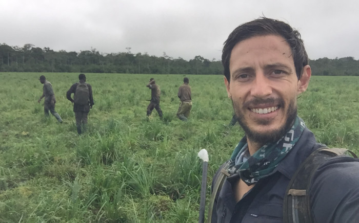South African wildlife vet Joe Alves and his team of trackers in a natural forest clearing shortly after collaring an elephant cow. Picture: Joe Alves