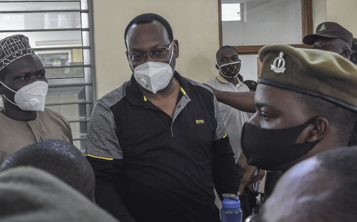 Tanzania Chadema party chairman Freeman Mbowe stands in the dock at Kisutu Resident Magistrate's Court in Dar es Salaam on 6 August 2021. Mbowe faces two charges of conspiracy to commit crimes and financing of terrorist acts. Picture: AFP