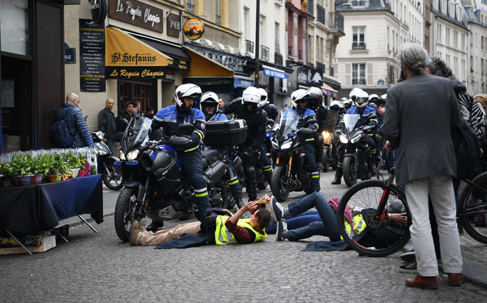 """Protesters taking part in an event called """"BenallApero"""", on 1 May, 2019, prevent police from accessing the Contrescarpe square in Paris, a site where a former Elysee senior security officer had been caught on video hitting a protester during a May Day rally. Picture: AFP"""