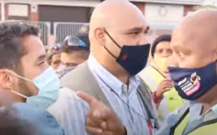 A screengrab of Cape Town Mayor Dan Plato (right) confronting an Ocean View resident during a walkabout in the area on20 March 2021. Picture: YouTube