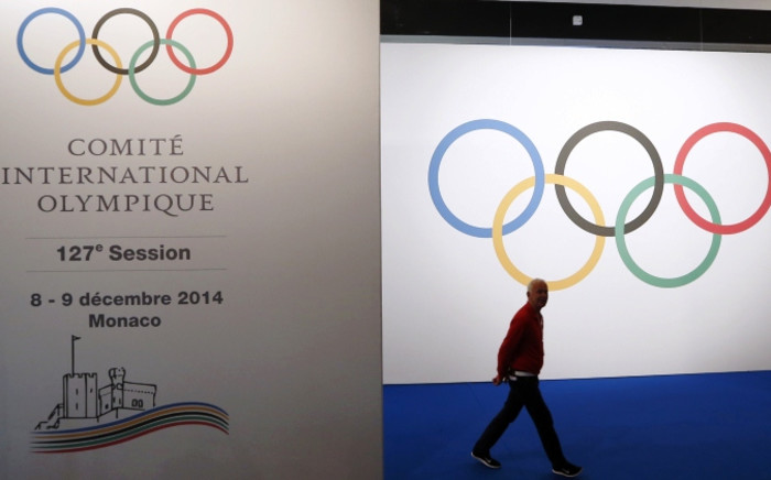 A man arrives on 8 December, 2014 for the 127th International Olympic Committee extraordinary session in Monaco. Picture: AFP.