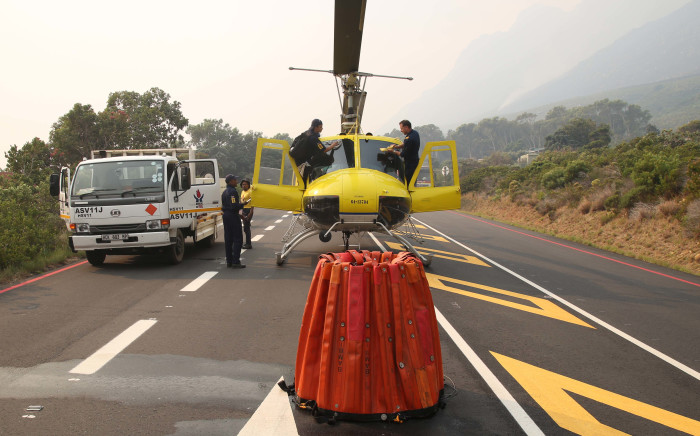 FILE: A Working On Fire chopper lands on a stretch of road while fighting the Overstrand fires near Cape Town. Picture: Bertram Malgas/EWN.