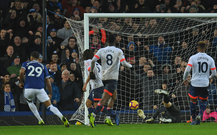 Everton's English striker Dominic Calvert-Lewin (L) celebrates scoring his team's second goal during the English Premier League football match between Everton and Bournemouth at Goodison Park in Liverpool, north west England on January 13, 2019.