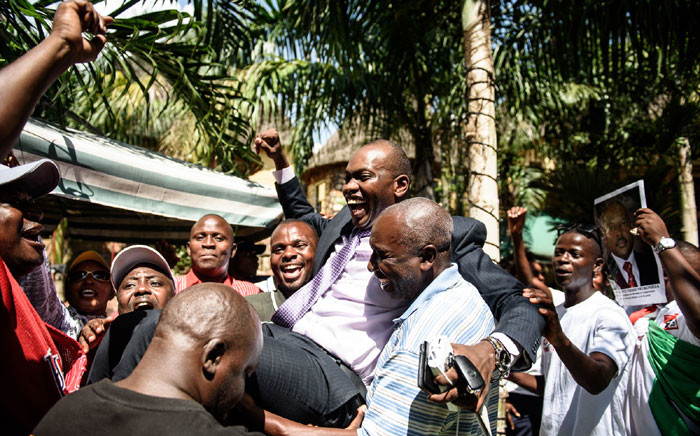 This file photo taken on 15 May 15 2015 shows Willy Nyamitwe (C) being carried by supporters in the Kamenge quarter of Bujumbura. Picture: AFP.