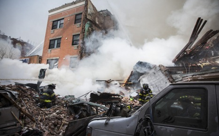 FILE: Heavy smoke pours from the debris after a building collapse at 1646 Park Ave in the Harlem neighborhood of Manhattan March 12, 2014 in New York City. Picture: AFP.