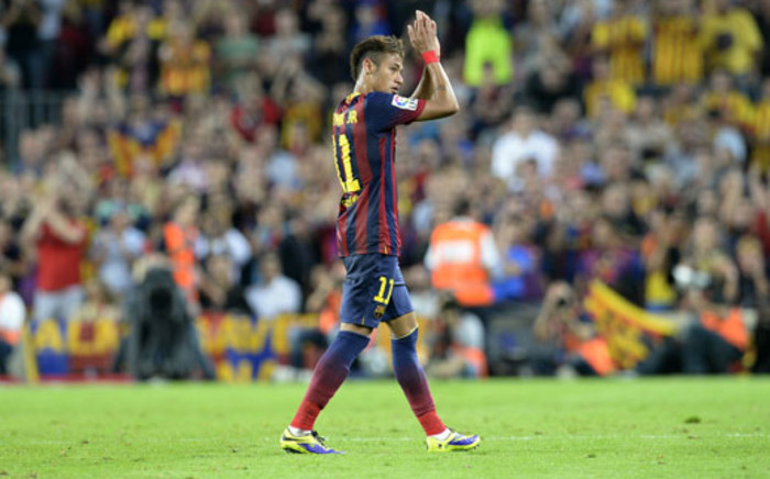 Barcelona's Brazilian forward Neymar da Silva Santos Junior applauds as he leaves the pitch during the Spanish league Clasico football match FC Barcelona vs Real Madrid CF at the Camp Nou stadium in Barcelona on 26 October 2013. Picture: AFP/LLUIS GENE