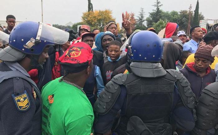 Police confront community members outside the Coligny magistrates court on 8 May 2017. Picture: Kgothatso Mogale/EWN