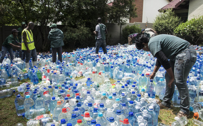 """Gauteng resident Kelly-Ann Van Der Meer founder of NGO """"One small act of kindness"""" has collected 69 tons for Cape Town animal shelters. Gift of the Givers will deliver the water in the coming days. Picture: Ihsaan Haffejee/EWN"""