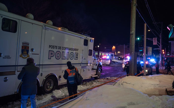FILE: Canadian police officers respond to a shooting in a mosque at the Québec City Islamic cultural center on Sainte-Foy Street in Quebec city on January 29, 2017. Picture: AFP.