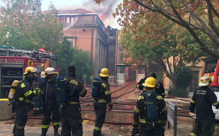 Firefighters put out a fire at a building on UCT's upper campus on 18 April 2021. Picture: @CityofCT/Twitter