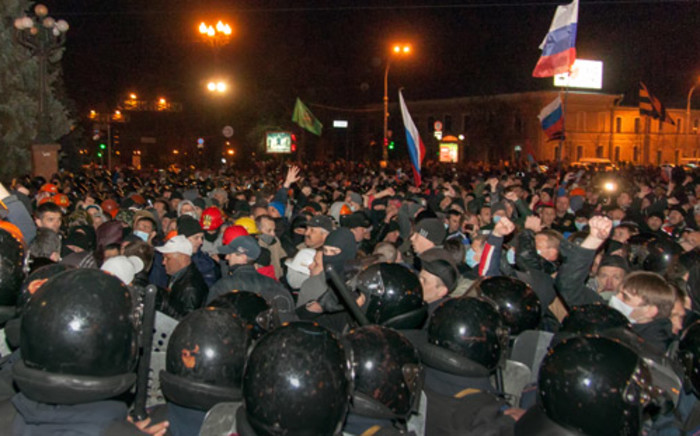 Pro-Russian protesters, some holding Russian national flags, storm regional administration buildings in the eastern Ukrainian city of Kharkiv on 6 April, 2014. Picture: AFP.