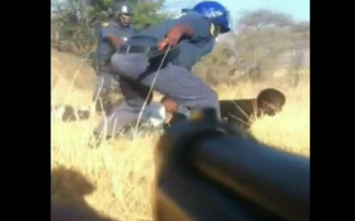 A screengrab of cellphone footage taken from the Marikana massacre.