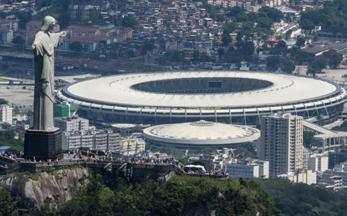 FILE: Aerial view of the Christ the Redeemer statue atop Corcovado Hill and the Mario Filho (Maracana) stadium in Rio de Janeiro. Picture: AFP.