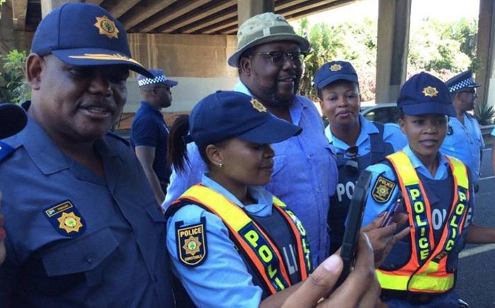 Acting national police commissioner Khomotso Phahlane (left) and Police Minister Nkosinathi Nhleko (centre) visit Durban on 31 December 2016. Picture: SAPS.