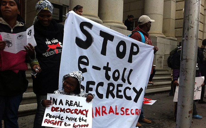 DA members picketing outside the Western Cape High Court against Sanral's application to keep tolling details secret on 4 August 2014. Picture: Siyabonga Sesant/EWN.