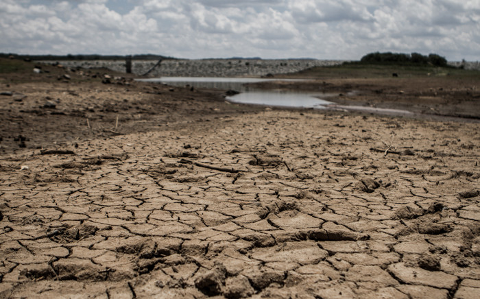 A photo taken on 7 February 2016 shows the fast-drying catchment area of the Umzingwani dam in Matabeleland, south-western Zimbabwe. Picture: AFP.