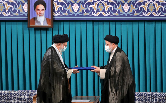 A handout picture provided by the office of Iran's Supreme Leader Ayatollah Ali Khamenei on 3 August 2021, shows him (L) during the inauguration ceremony for Ebrahim Raisi (R) as President, in Khamenei's office in the capital Tehran. Ultraconservative Raisi was inaugurated as president of Iran, a country whose hopes of shaking off a dire economic crisis hinges on reviving a nuclear deal with world powers. Picture: AFP